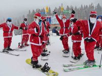 A bevy of Santas collaborate at Brighton Ski Resort, UT. Credit: Harriet Wallis