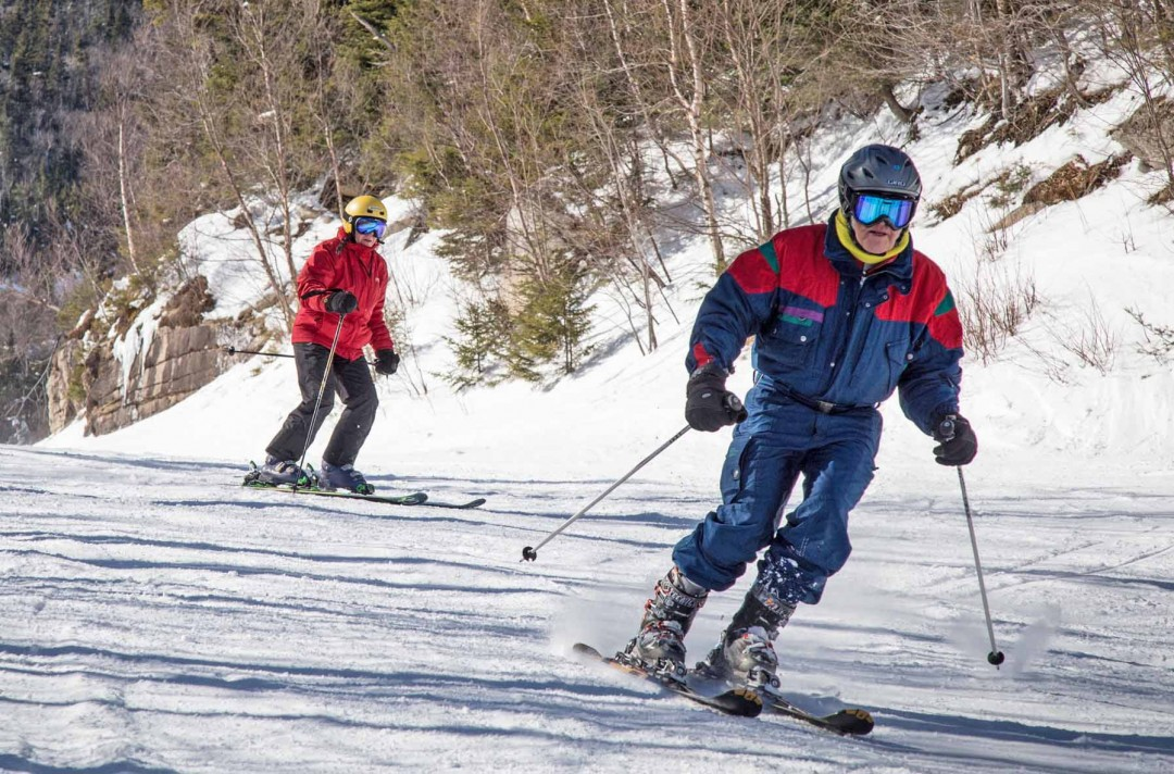 Senior Skiers take lessons at Waterville Valley Resort. Good technique means more enjoyable skiing. Credit: Steve Bryan