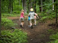 Family hiking in Smuggler's Notch is a perfect summer vacation. Credit: X-CSkiResorts.com