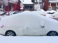 Snow-covered Prius shows depth from one-day storm in SLC.