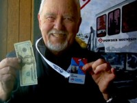 Reviewer Jan gleefully shows off his $20 season pass for 75+ skiers. Credit; Jan Brunvand