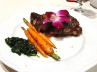 Organic spinach, carrots and lamb topped with a wildflower.  Credit: Harriet Wallis