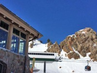 The Needles Lodge and Gondola at SnowBasin on a bluebird day. Credit: Jon Weisberg