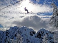 A skier rides the upper-elevation Edelweiss Chair at Alpental. Credit: John Nelson
