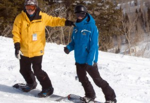 Former skier, now boarder, Dave Hayes with son learning how-to. Credit: Dave Hayes