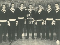 Bowdoin College ski team circa 1958 with state championship trophy.  John Christie is third from right.  He was originally a reluctant competitor.  Credit: John Christie