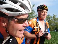 Tour de France winner Greg LeMond snapping pics on charity ride with Pat McCloskey.