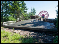 Spruce Peak's bull wheel was pulled downhill by the weight of the cable and chairs after the foundation gave way. Credit: WCSH