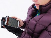 Are Smartphones an insidious barrier to socializing on the slopes?  Credit: Harriet Wallis