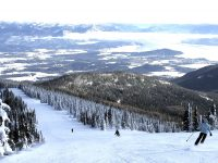Much of the skiing at Schweitzer Mountain has great views of Lake Pend Oreille and the surrounding mountains. Credit: John Nelson