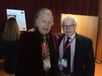Ski legend Doug Pfeiffer and SeniorsSkiing.com co-publisher Mike Maginn reconnect after many decades at the ISHA Hall of Fame ceremony at Stowe.