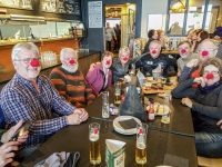 Jolly time at Masters Week apres ski party at Big White Ski Resort. The Masters program is aimed at skiers of all levels over the age of 50.  Credit: Yvette Cardozo