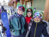 Women in Big White Ski Resort Masters ski program show off their green hair helmet decorations. The program runs a week with lessons in the morning and social programs at night. Kelowna, BC. Credit: Yvette Cardozo