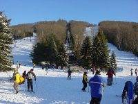 Small is better? Accessible, economical, family-friendly, local ski areas have a community feeling. Credit: Ski Sundown