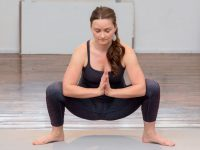 Malasana or garland pose is a squat sit that might be a good place to start. Credit: REI