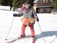 Paul in his tutu. He skis every day, but not always in a tutu. Sometimes he tows a kite from his helmet. Credit: Harriet Wallis