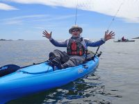 WhyKnotFishing guide Matt Zimmerman teaches how-to kayak and fish in Marblehead Harbor. Credit: Tamsin Venn