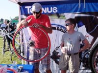 The dealer installs tubeless Tannus tires onto my rims before the big charity ride. Credit: Harriet Wallis