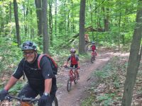 Check the smiles and the kids on the nice smooth single track. Credit: Pat McCloskey