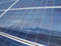Aspen Mountain reflected in Solar Panels at resort. Credit: Aspen Skiing Company