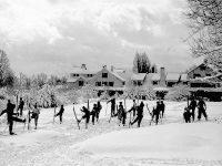 A ski class practicing kick turns at Peckett's-on-Sugar Hill, 1930s, where, for the first time, Americans could take lessons with skilled Austrian. Credit: Concord Monitor