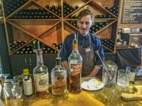 Bar Supervisor Tom Falland creating his signature Smoked Old Fashioned drink at the Den Bar and Bistro in Silver Star Mountain, BC. Credit: Yvette Cardozo