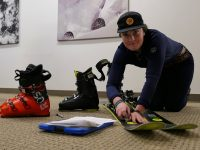 Maura Grady of Ski Butlers adjusts the bindings on Rossignol Soul 7 HD skis, one of the models the company offers. Credit: Jon Nelson