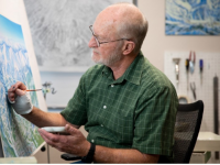 James Niehues in his studio, creating maps by hand. Credit: LA Times