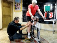 Harriet gets fit in a bike shop studio with an Oriental rug on the floor. Credit: Harriet Wallis