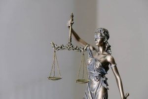 lady justice's scales showing that sharing should be fair