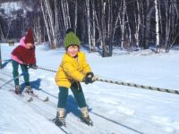 Riding the rope. Harriet's daughter Alison, 5, in leather boots and wooden skis on Jiminy Peak's rope tow. Credit: Harriet Wallis
