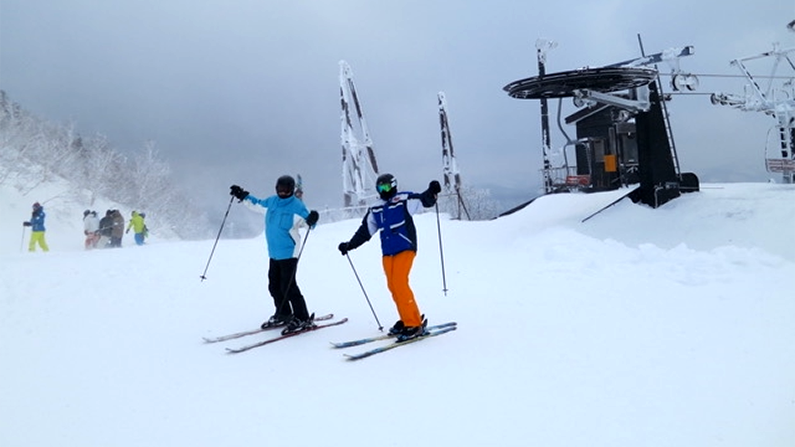 Skiiers at top of lift